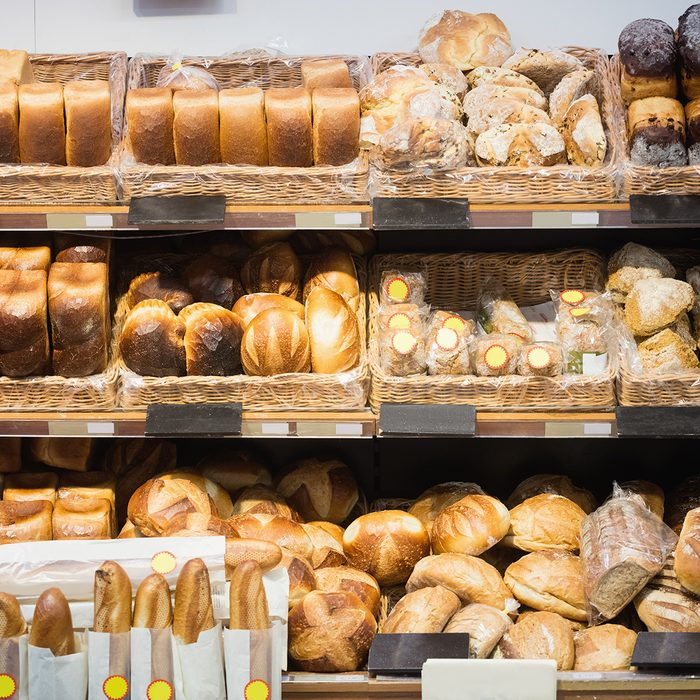 Focus on shelves with bread in a supermarket