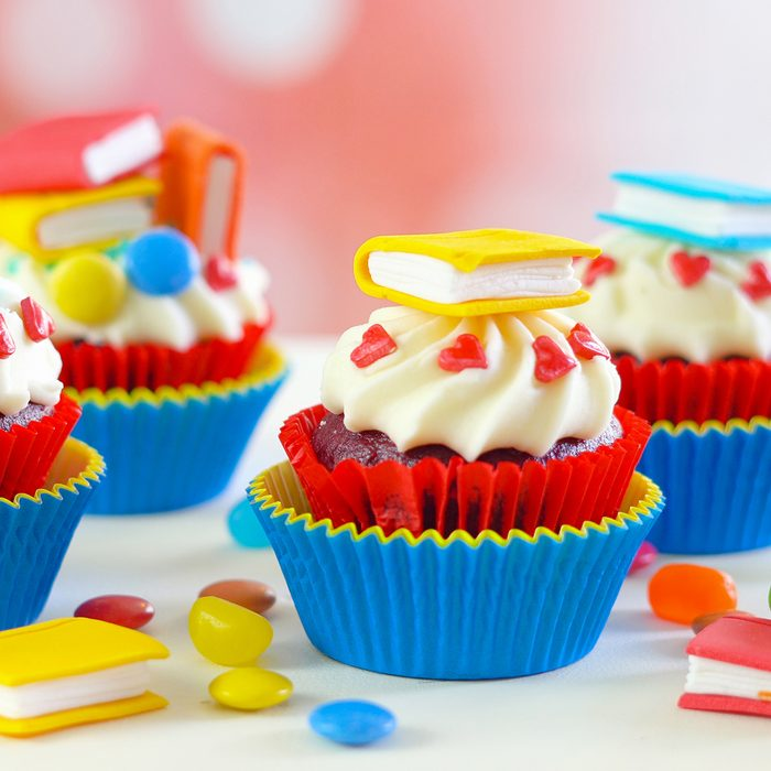 Bright colorful Back to School theme cupcakes with candy sugar art book topper decorations
