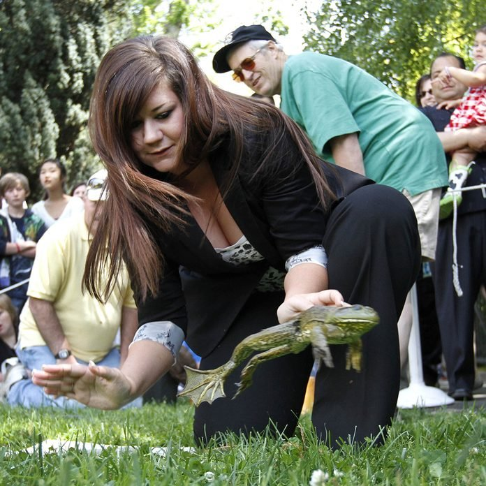 """Jessica LaMaack, representing Sen. Jean Fuller, R-Bakersfield, watches her frog, """"Frogen-Dazs,"""" make its leap during the annual Capitol Frog Jump contest in Sacramento, Calif.,"""