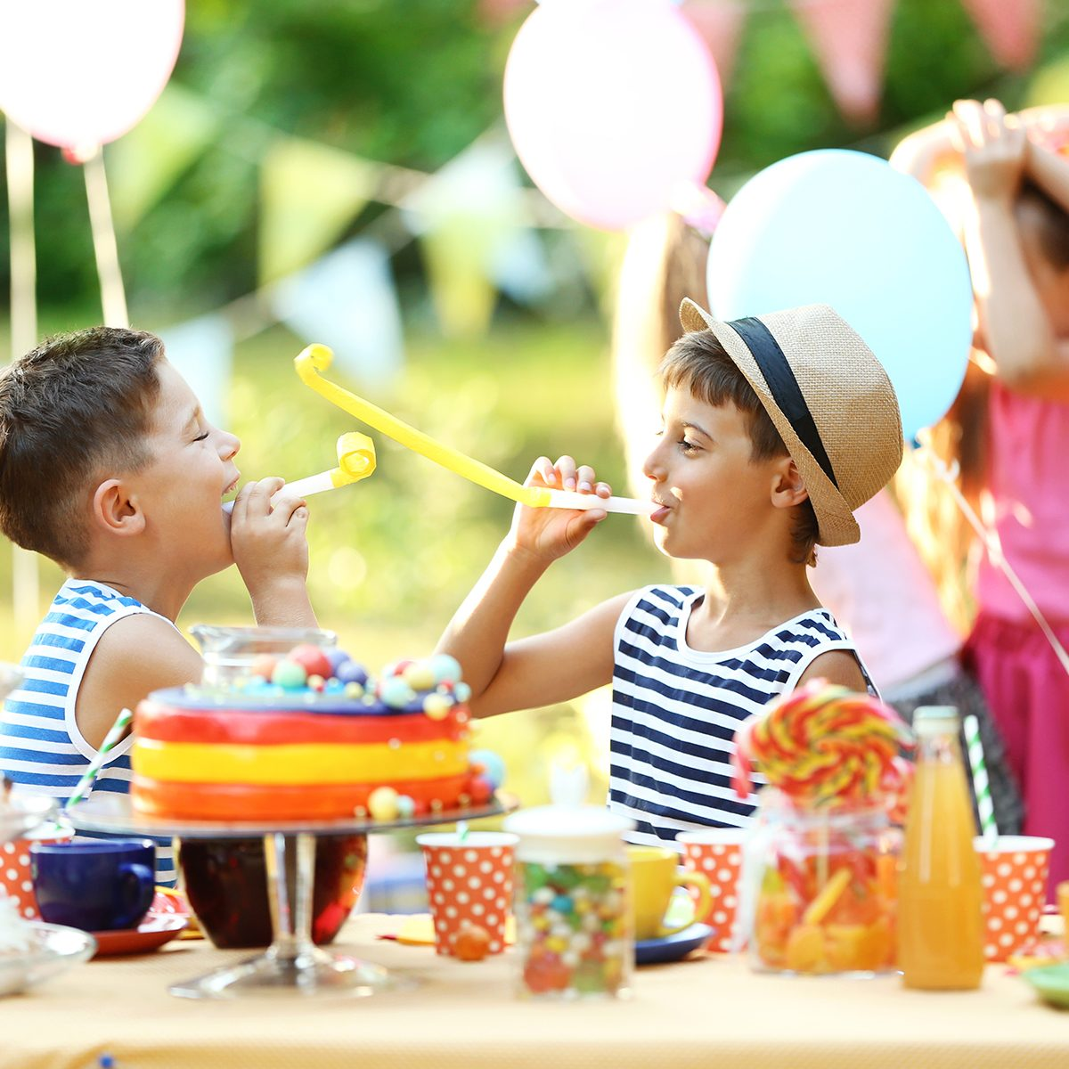 Children celebrating birthday in park