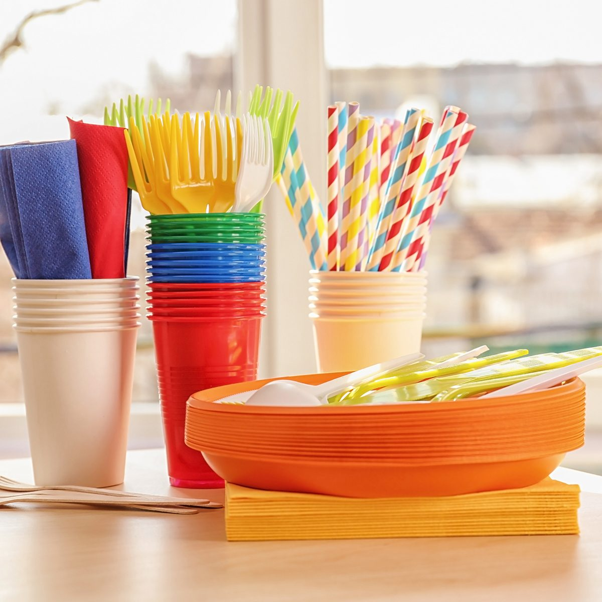 Colorful plastic ware for picnic on table