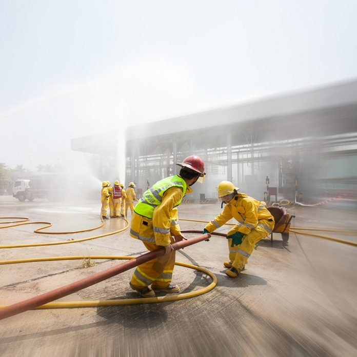 Blurred of Many people at work preparing for training firefighters