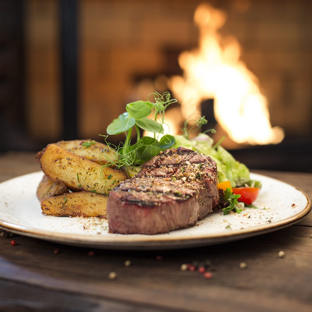 Food - Beef dinner - Delicious grilled stake and potatoes served on a wooden table
