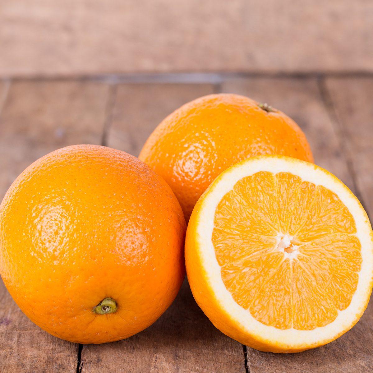 fresh, juicy, orange on a wooden background