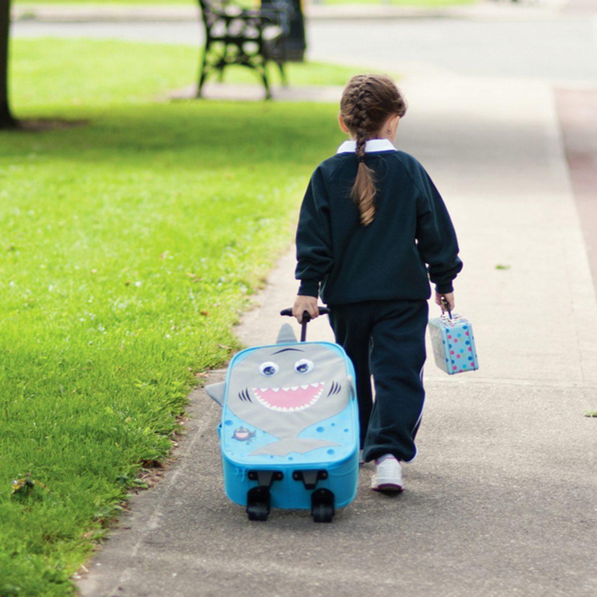 Little girl walking from school