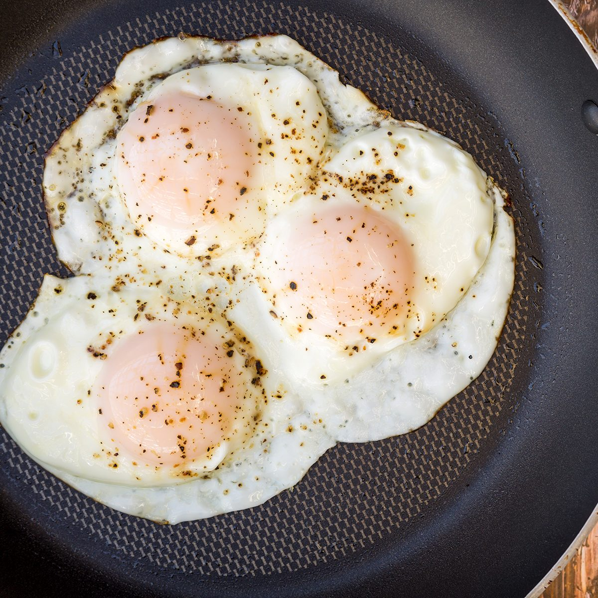 Over-easy eggs with fresh salsa and coffee