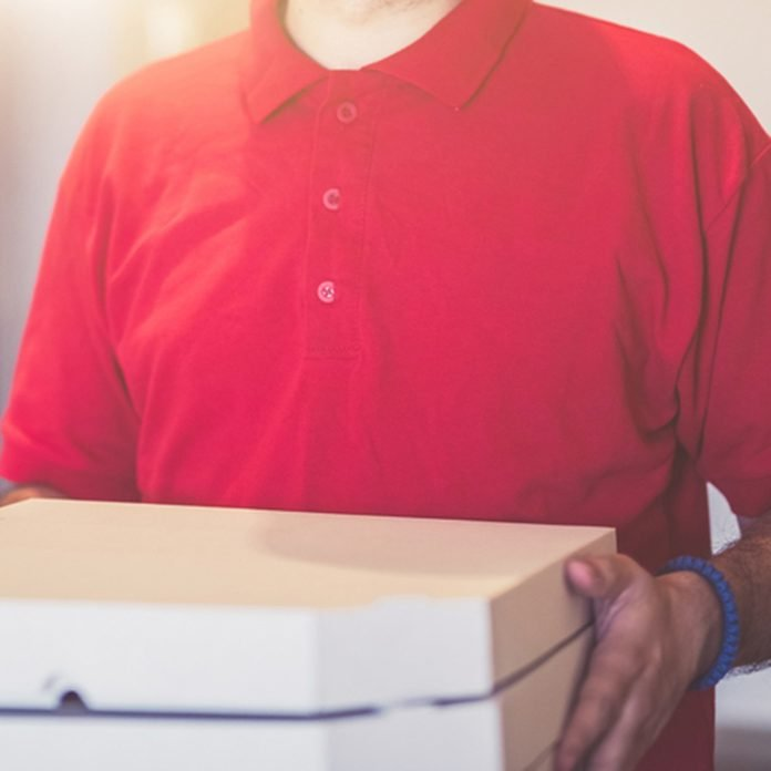 Pizza delivery man in red shirt