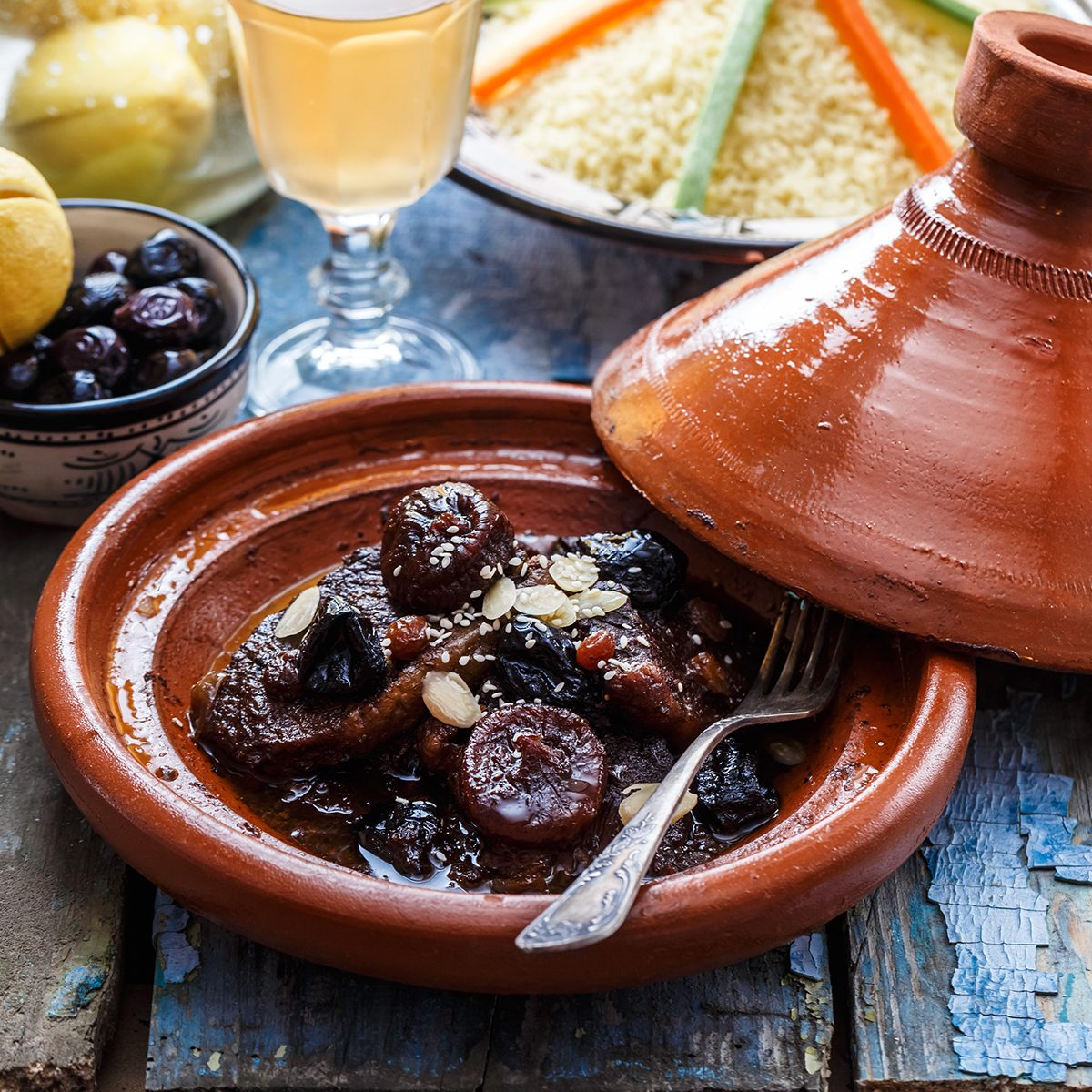 Slow cooked beef with prunes, figs, raisins and almonds - moroccan tajine.