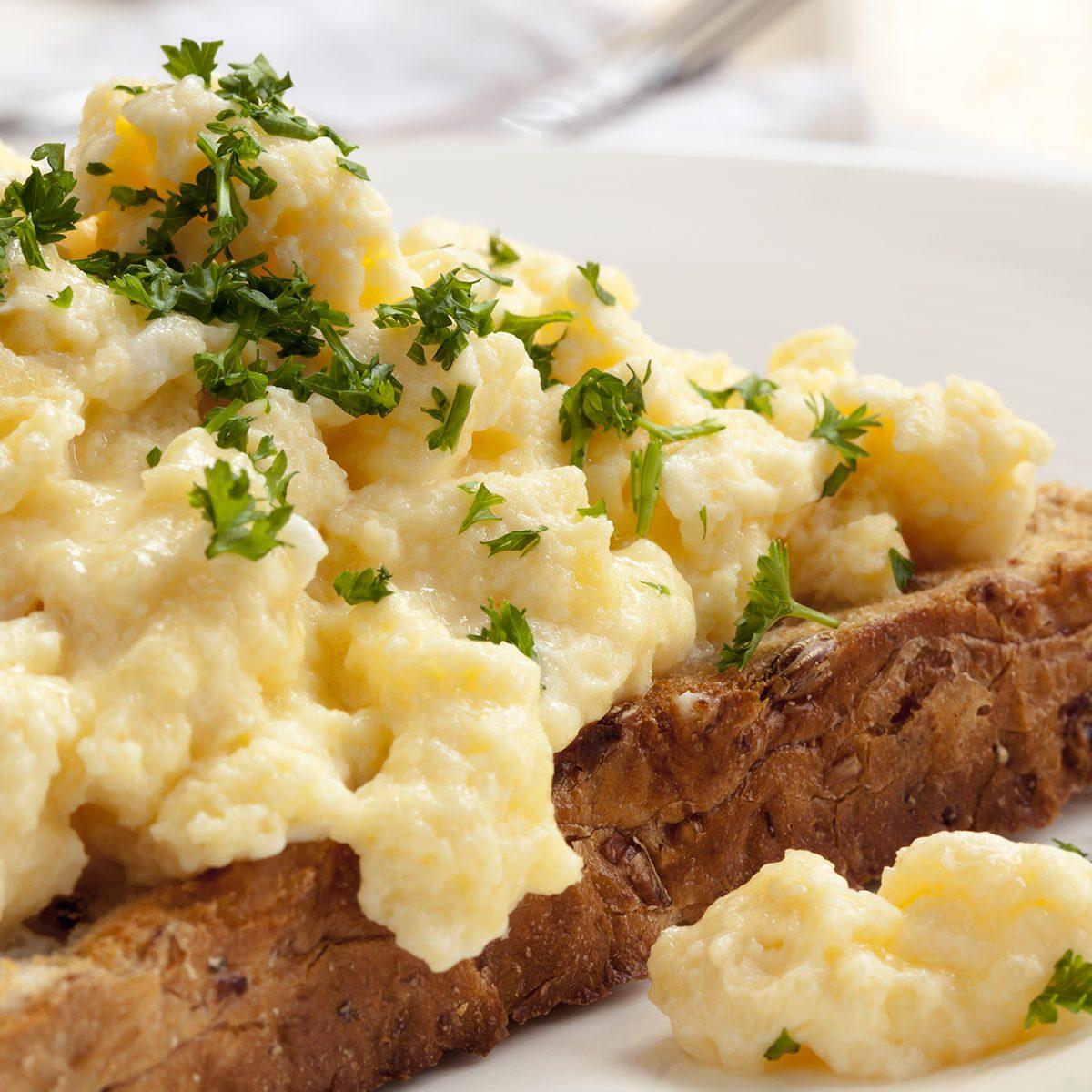 Scrambled eggs on toasted wholegrain bread.