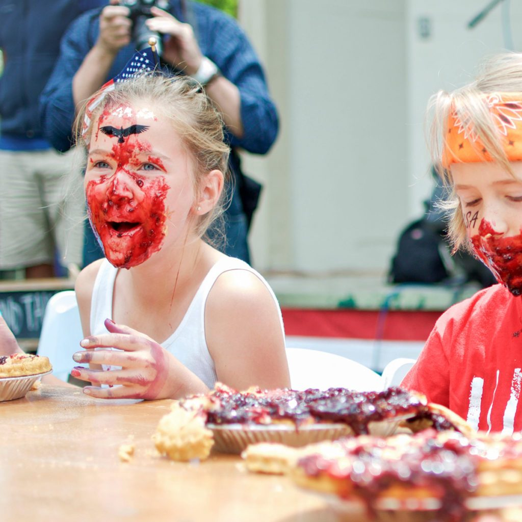 Twisp, Washington/ United States- 7/4/2016: Two young children look over the remains of their pies at the end of a 4th of July pie eating contest in the Methow Valley; Shutterstock ID 1122167222; Job (TFH, TOH, RD, BNB, CWM, CM): Taste of Home