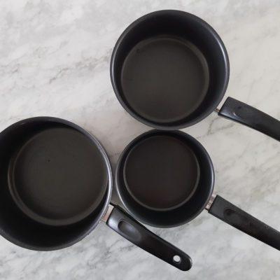 Three saucepans with handles