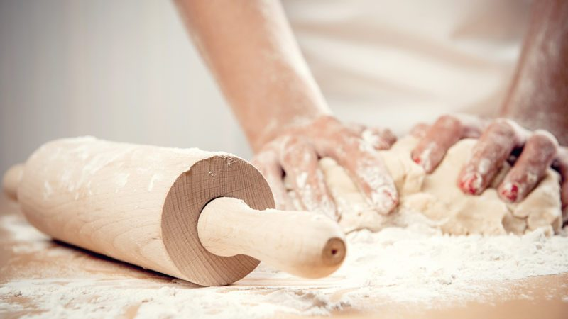 Woman kneading dough, close-up photo; Shutterstock ID 139422398