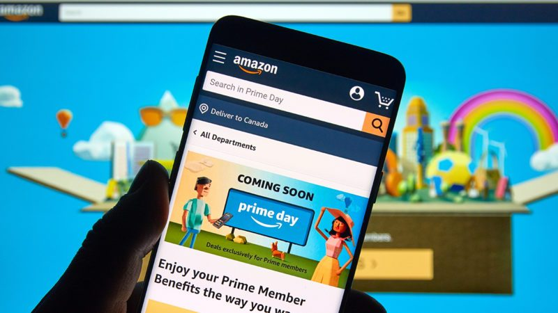 MONTREAL, CANADA - JUNE 9, 2019 : Amazon prime day page and logo on android cell phone over Amazon home page. Amazon Prime Day is the retailer's big members-only summer sale in month of July each year; Shutterstock ID 1419761330; Job (TFH, TOH, RD, BNB, CWM, CM): Taste of Home