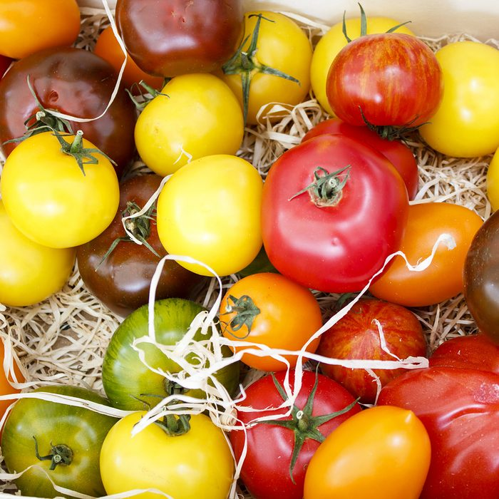 Variety of multi-colored tomatoes on a srtaw at one of Parisian food markets; Shutterstock ID 150962780; Job (TFH, TOH, RD, BNB, CWM, CM): Taste of Home
