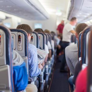 Interior of airplane with passengers during flight. ; Shutterstock ID 395043589; Job (TFH, TOH, RD, BNB, CWM, CM): TOH