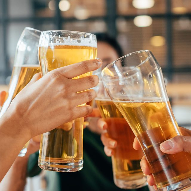 Close-up cropped image of friends clinking with beer in cafe; Shutterstock ID 684411964; Job (TFH, TOH, RD, BNB, CWM, CM): Taste of Home
