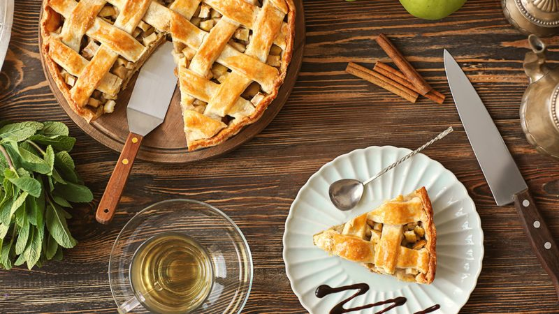 Composition with tasty homemade apple pie on wooden background