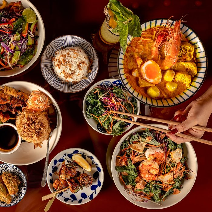 Thai food selection, top down view of multiple dishes.