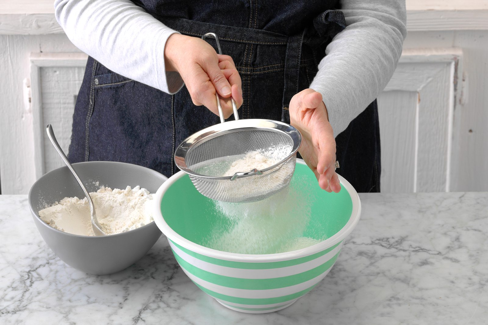 Sifting flour for cake