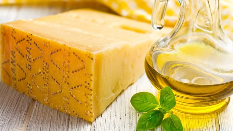 Italian hard cheese with basil and olive oil