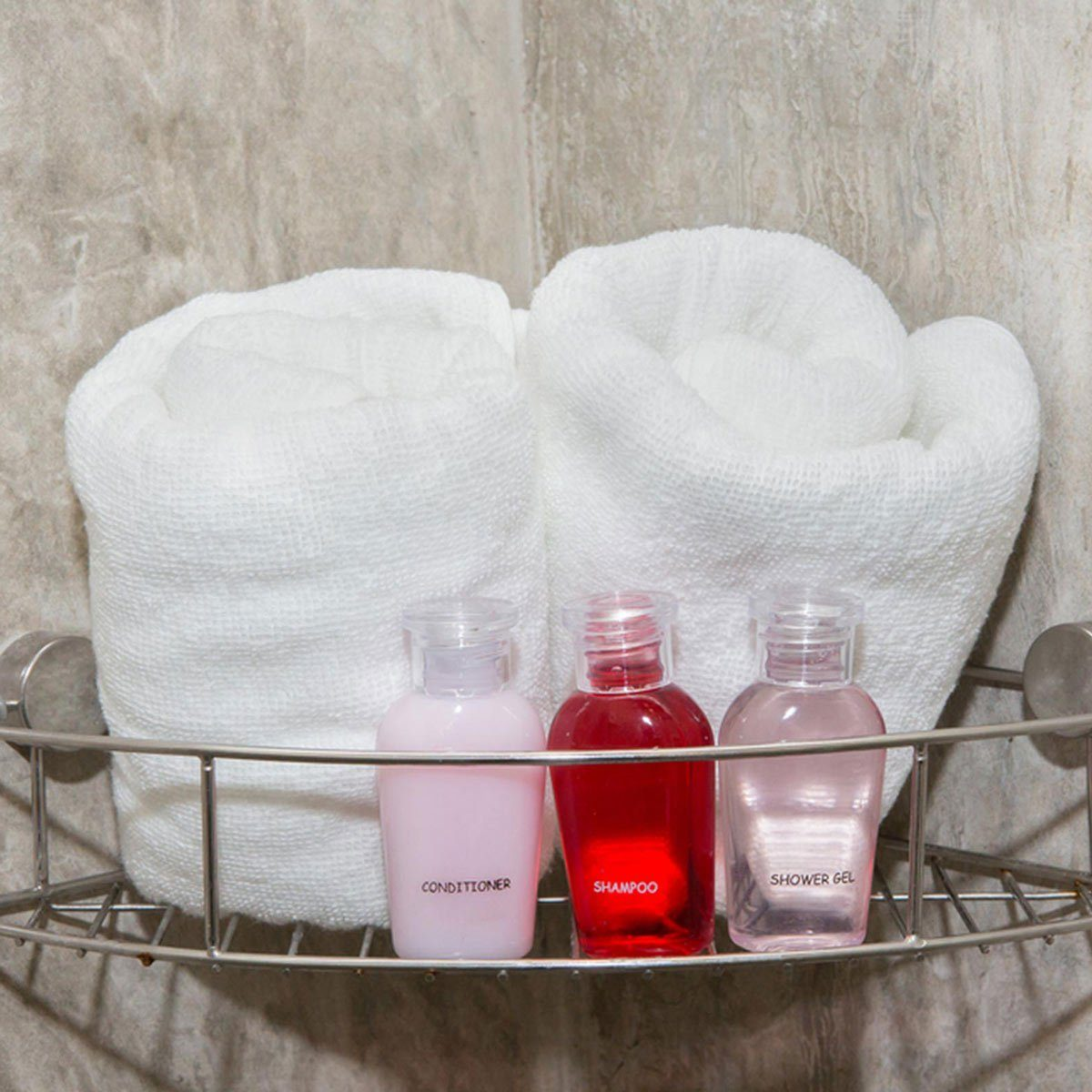 Shower caddy with soap, shampoo and two towels
