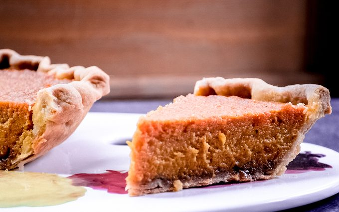 Sweet potato pie with slice cut out