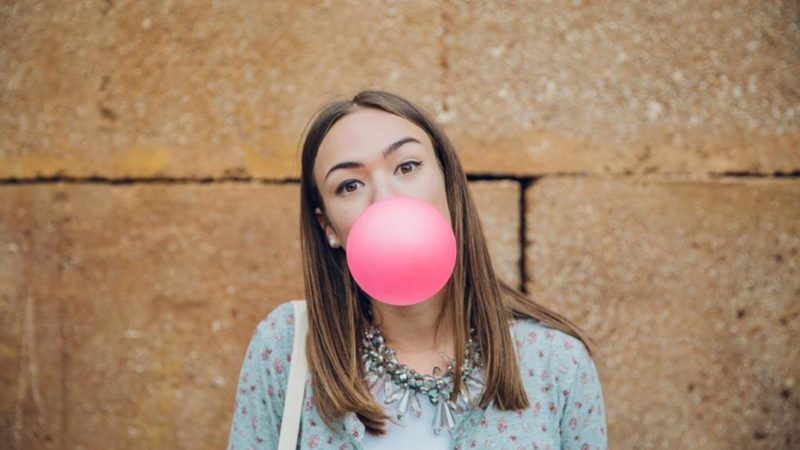 Woman blowing bubblegum bubble