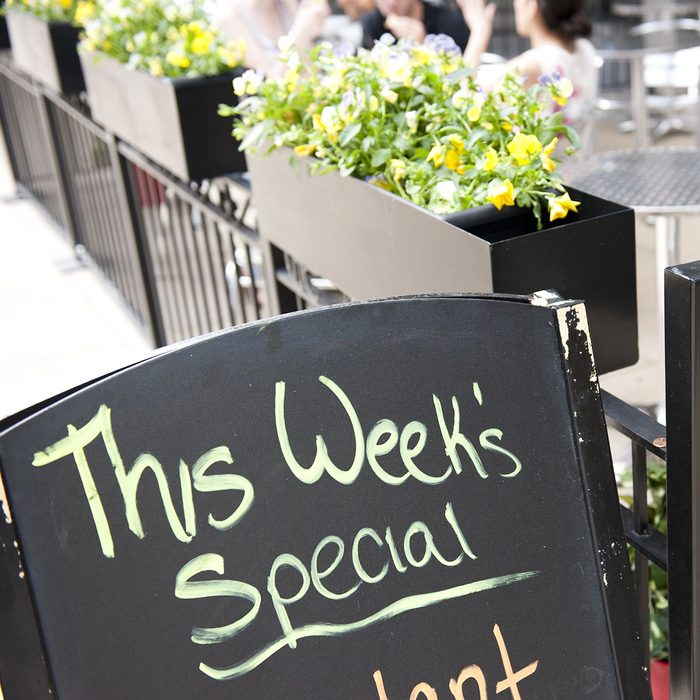 A blackboard in front of a cafe in Chicago, Illinois mentioning the special menu of the week.