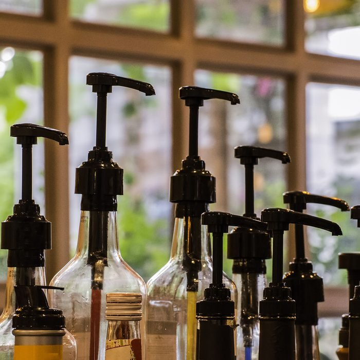 Bottles for syrup in coffee shop.