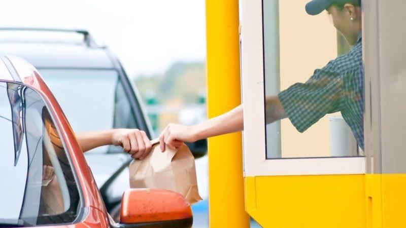 Drive thru fast food restaurant.(motion blur)