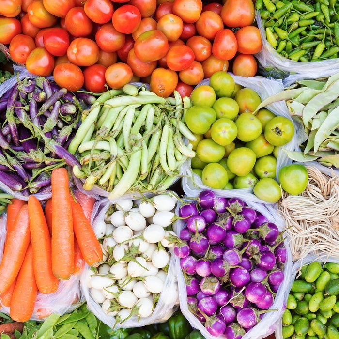 Farmers market with various domestic colorful fresh fruits and vegetable.