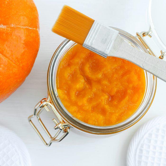 Homemade pumpkin face mask in a glass jar.