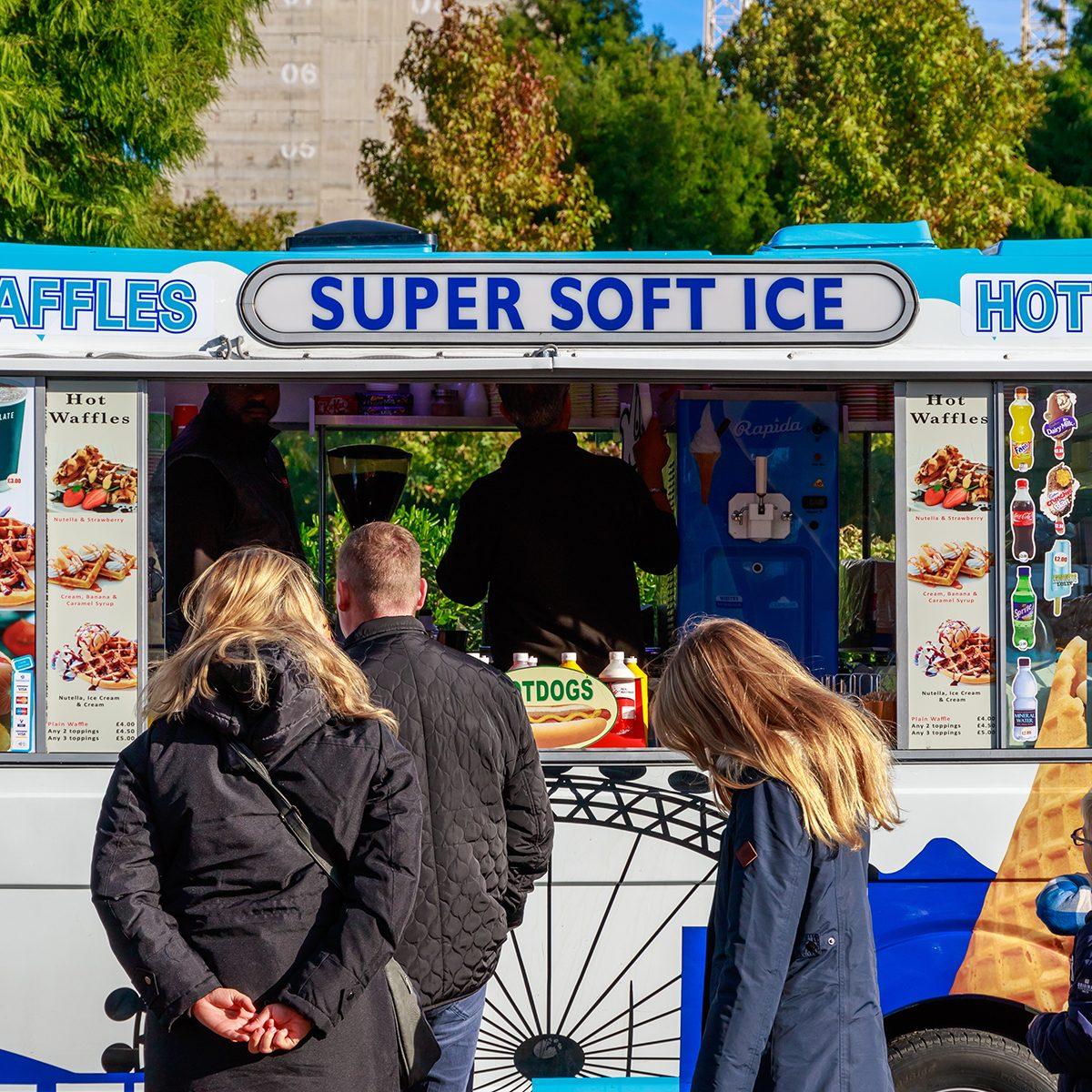 Ice cream van and customers on London street