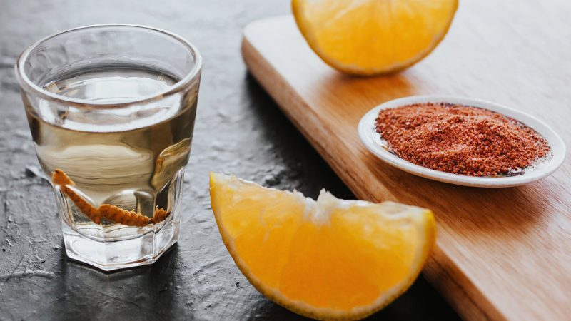 mezcal shot with chili salt and agave worm, mexican drink in mexico