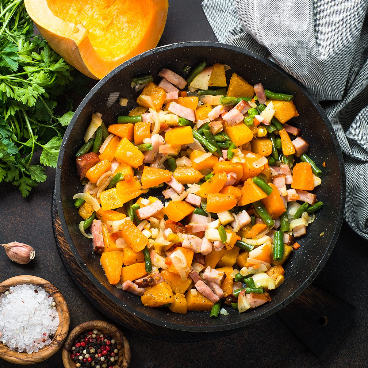 Pumpkin fried with vegetables and smoked meat.