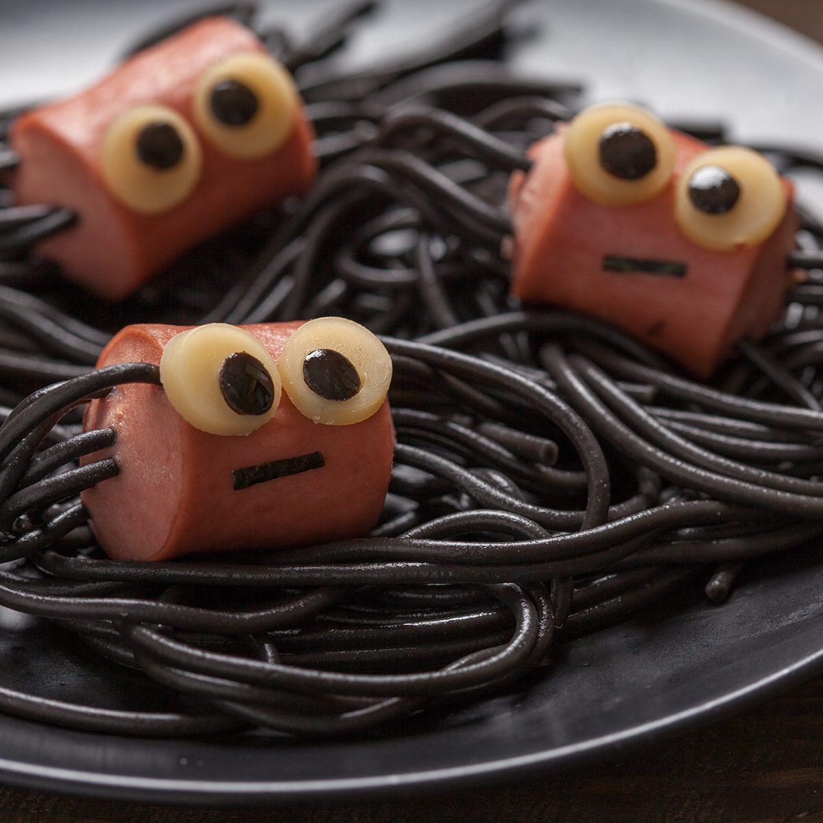 Sausage and spaghetti funny spiders for Halloween kids lunch