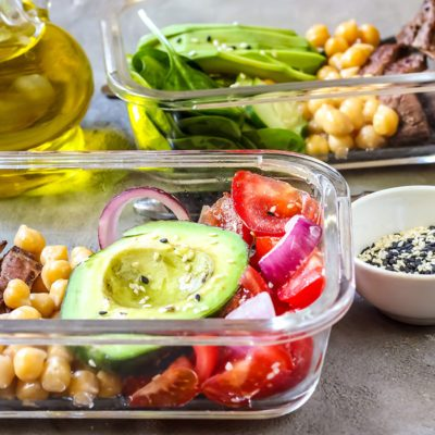 Healthy meal prep containers with chickpeas, goose meat , tomatoes, avocado, lemon and spinach. Top view; Shutterstock ID 1081277720; Job (TFH, TOH, RD, BNB, CWM, CM): Taste of Home