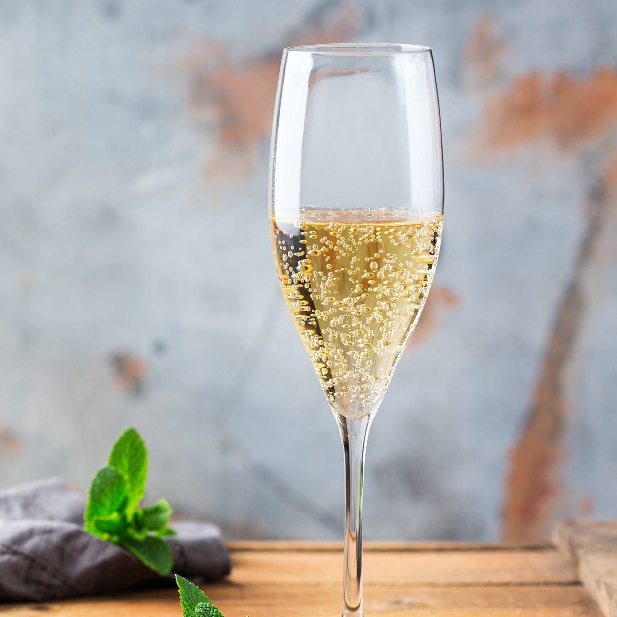 Food and drink, holidays party concept. Cold fresh alcohol beverage champagne sparkling white wine with bubbles in a flute glass on a wooden table. Copy space background; Shutterstock ID 1086809027; Job (TFH, TOH, RD, BNB, CWM, CM): TOH