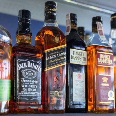 Gdansk, Poland - May 24, 2018: Selection of whiskey bottles on the bar shelf. Selective focus on the Johnnie Walker Black Label bottle.; Shutterstock ID 1101170873; Job (TFH, TOH, RD, BNB, CWM, CM): Taste of Home