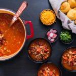 Turkey chili garnished with fresh radishes, green onions and cheddar cheese; Shutterstock ID 1195983994; Job (TFH, TOH, RD, BNB, CWM, CM): Taste of Home