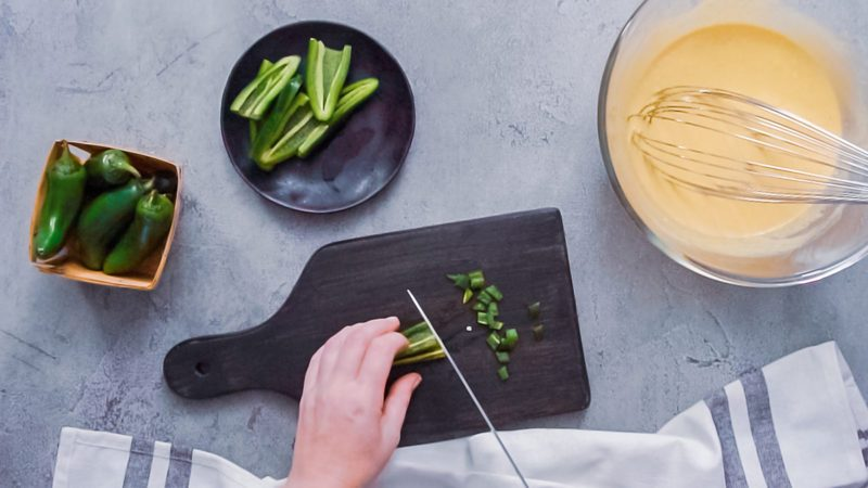Step by step. Flat lay. Slicing jalapeno peppers for spicy jalapeno cornbread.