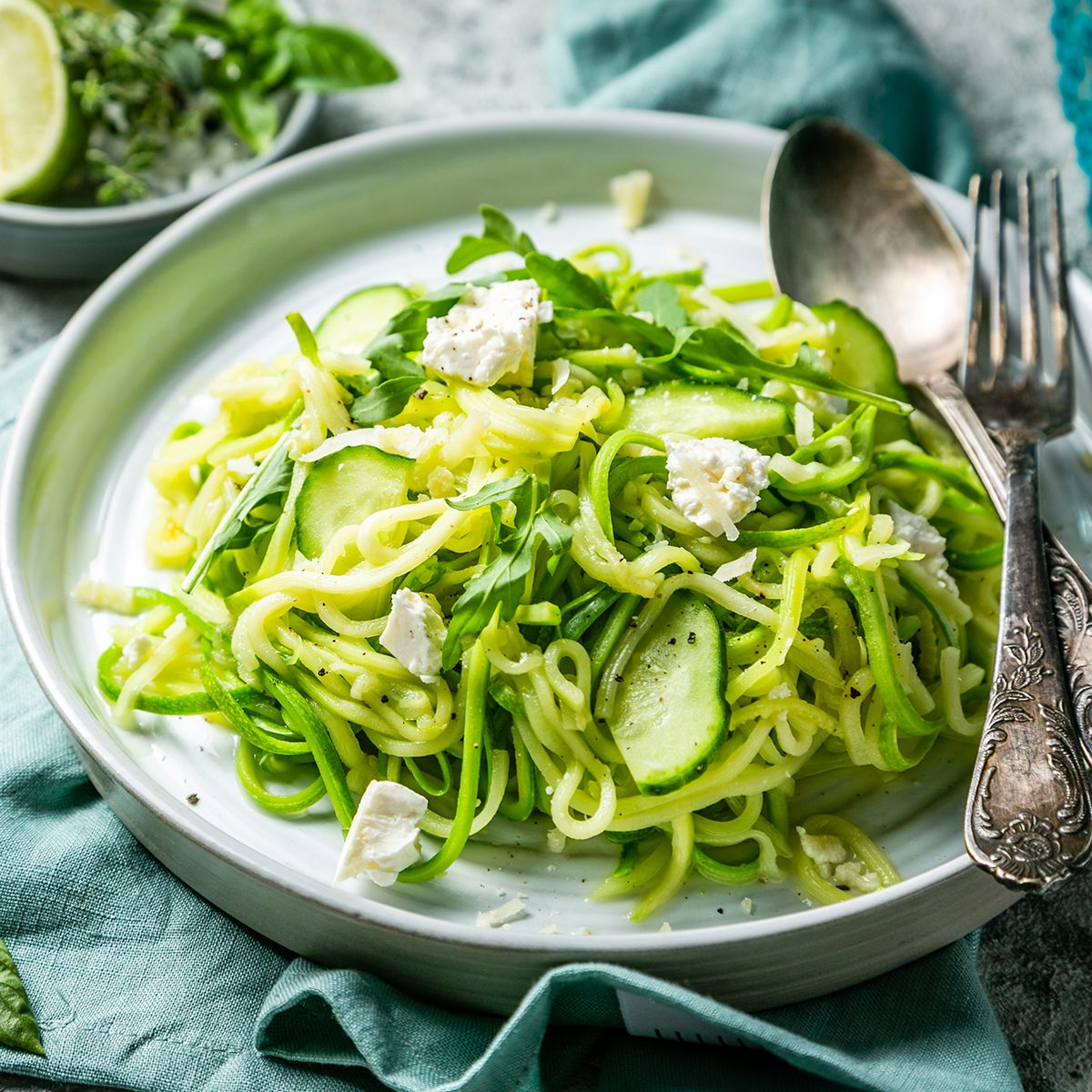 Zucchini noodles with cucumber, feta cheese and arugula, rustic background; Shutterstock ID 1220659900; Job (TFH, TOH, RD, BNB, CWM, CM): Taste of Home
