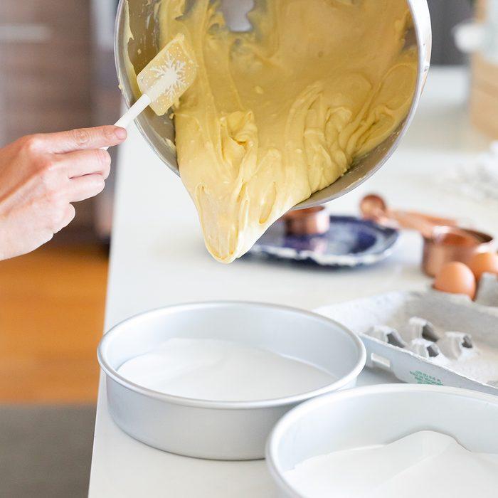 pouring vanilla batter into cake pan; Shutterstock ID 1485158234; Job (TFH, TOH, RD, BNB, CWM, CM): TOH