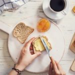 Woman hand spreading butter on sliced bread; Shutterstock ID 645603709; Job (TFH, TOH, RD, BNB, CWM, CM): Taste of Home