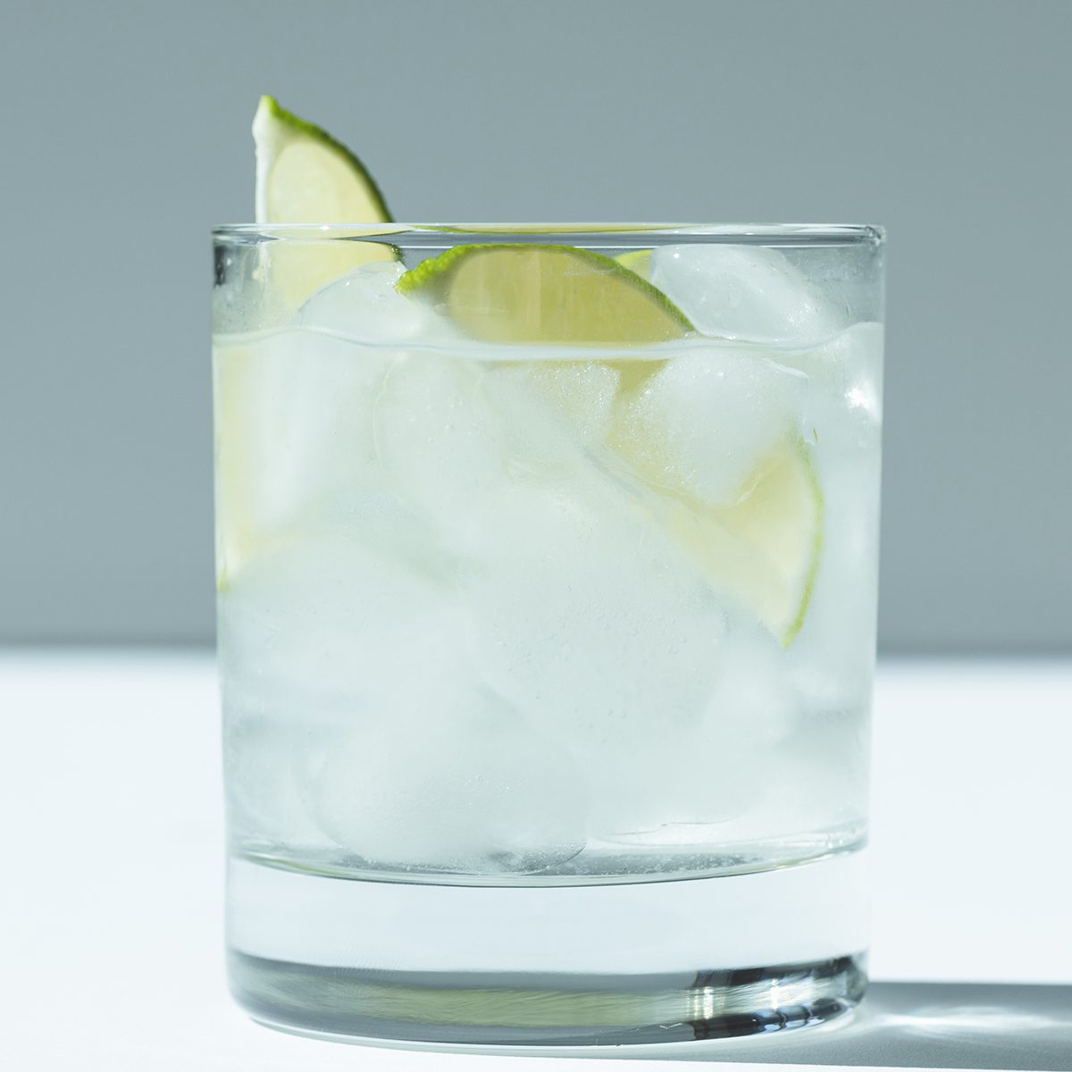 close-up view of Gin Tonic cocktail with lime and ice cubes in glass; Shutterstock ID 731431963; Job (TFH, TOH, RD, BNB, CWM, CM): TOH