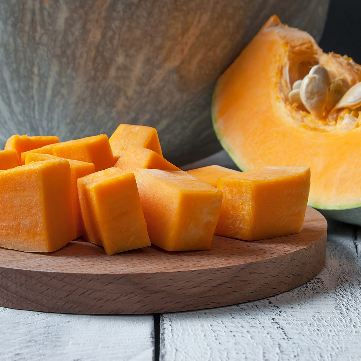 Sliced and chopped pumpkin pieces. Pumpkin with seeds.