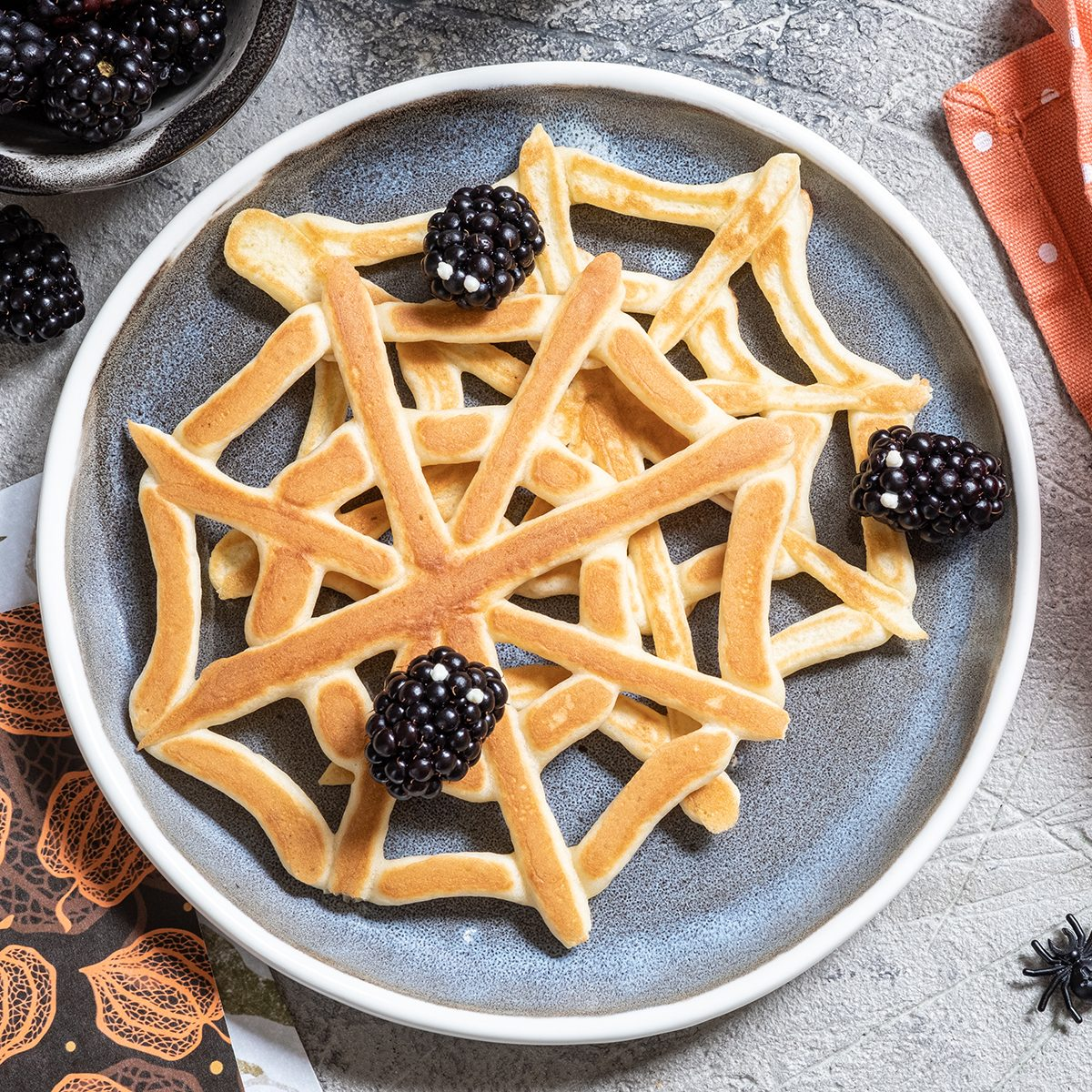Spider web pancakes with blackberry for Halloween breakfast
