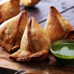 Vegetarian samsa or samosas.Indian special traditional street food punjabi samosa or Coxinha, Croquete and other Fried Brazilian Snacks.