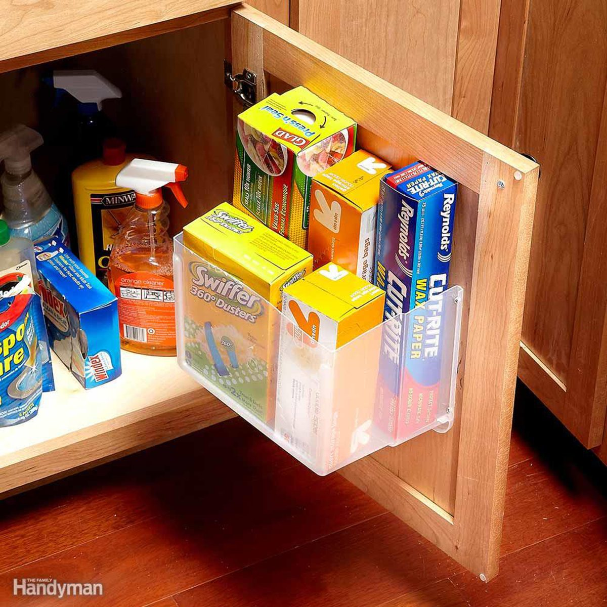 Boxes in a shelf on the door of a cabinet