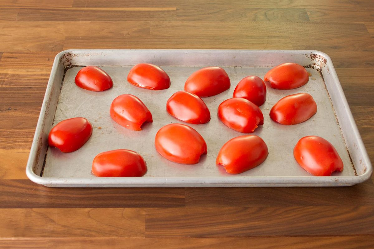 halved tomatoes on sheet pan